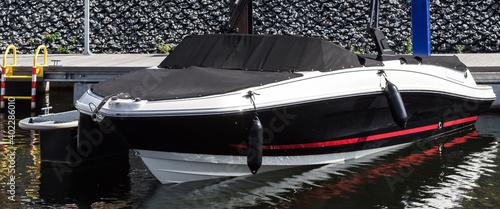 Obraz na plátně MOTORBOAT - Elegant fast boat at the marina quayside
