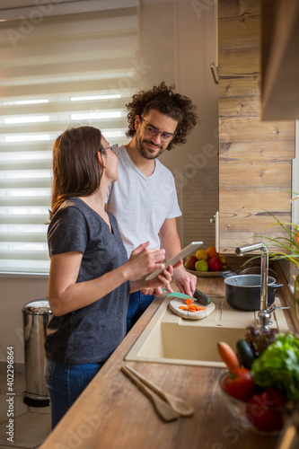 Fényképezés Couple in love cooking lunch together