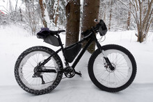 Extreme Sport. Bikepacking In The Winter Forest. Fat Bike With Studded Winter Tire.