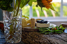 Platter Of Cheeses Arranged On Natural Wooden Serving Board
