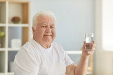 Positive Senior Man Keeps Healthy Preventing Dehydration By Drinking Enough Water
