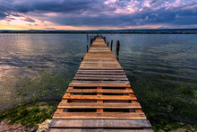 Exciting View From The Shore With A Wooden Pier