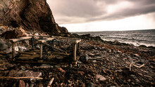 A Washed Up Lobster Cage On The Shore In The East Coast Of Canada.
