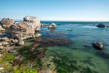 Sea Kayaking Overlooking Pacific Ocean, Rocky Cliffs And Caves, California Coastline