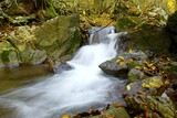 beautiful mountain river. fresh clear water on waterfall on autumn day