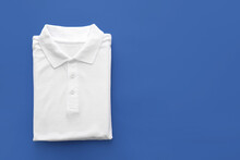 Folded Polo Shirt On Color Background