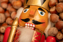 Wooden Figure In The Form Of A Soldier For Chopping Nuts And Hazelnuts In Bulk. It's Time For The Autumn Harvest. Close-up, Selective Focus.