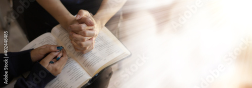 Obraz na plátně Close up of woman hands pray at church, Pray to God with blank space for text