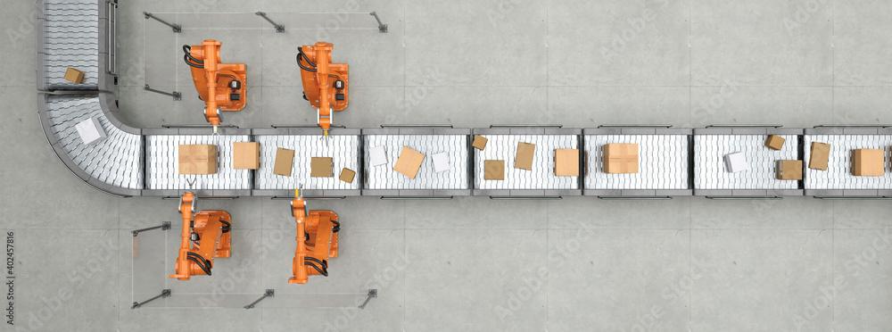 Fototapeta Fließband von oben in Logistikzentrum mit Paketen und Robotern