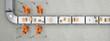 Leinwandbild Motiv Fließband von oben in Logistikzentrum mit Paketen und Robotern