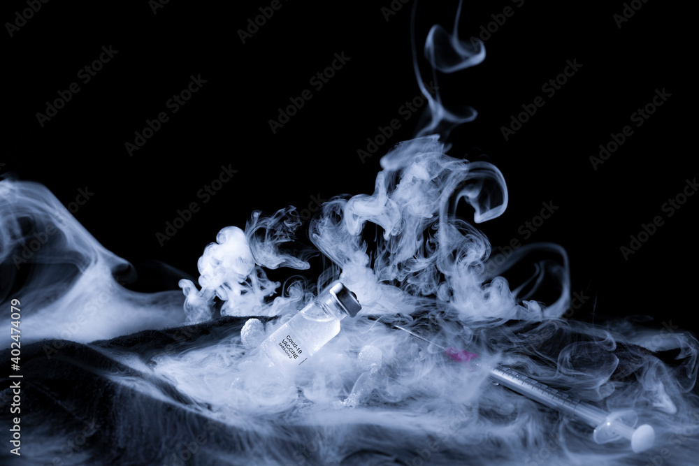 Fototapeta A Covid-19 vaccine preserved at very low temperature with carbon dioxide (dry ice) with a lot of steam