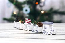 White Decorative Handmade Steam Locomotive. Steam Locomotive With Christmas Decor. Gifts In Locomotive Cars. Christmas Spirit