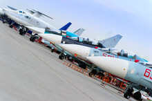 Fighter Planes Standing In Row On Runway, Modern Military Aircraft, Army Industry, Evening Sky On Background, Selective Focus