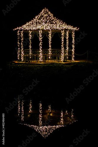 Fototapeta Illuminated garden pavilion at night obraz na płótnie