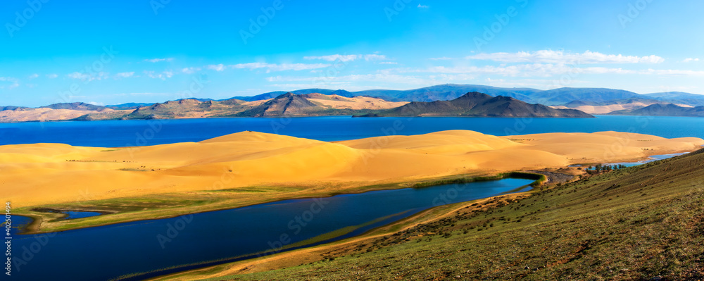 Fototapeta Lake is located in a fine sand dunes and mountains.