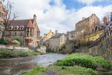 Dean Village A Typical Scottish Village With A River In Edinburgh, Scotland