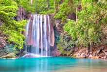 Beautiful Waterfall And Emerald Lake In Green Tropical Jungle Forest. Nature Landscape Of Erawan National Park, Kanchanaburi, Thailand