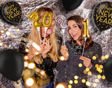 Fototapeta Natura - 2 young, pretty women with 2021 year numbers and new year's eve outfit and balloons make new year's party