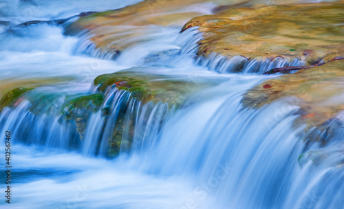Canvas Print closeup small brook rushing over the stones, beautiful natural background