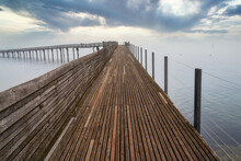Stunning Foggy View Of The Pedestrian Wooden Bridge (Holzsteg) Crossing The Zurich Lake At Its Narrowest Point Between Hurden (Seedam) And Rapperswil, Switzerland