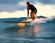 Slow Shutter - Female Surfer Dropping Into A Wave At Sunset - Gold Coast