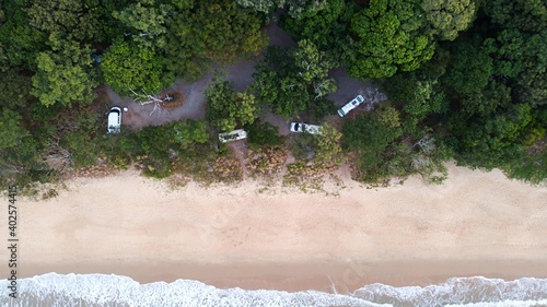 Fototapeta Campervans parked in a beachside campspot on Queenslands tropical North coast