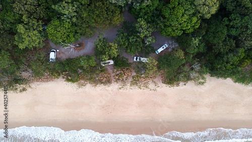 Slika na platnu Campervans parked in a beachside campspot on Queenslands tropical North coast