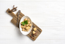 Marinated Champignon Mushrooms With Spice In White Bowl On Wooden Board