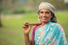 Women Farmer On Farm Field