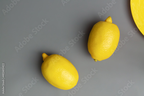 yellow-lemons-on-gray-background-colors-of-the-year-2021-pantone-illuminating-and-ultimate-gray-flat-lay-copy-space