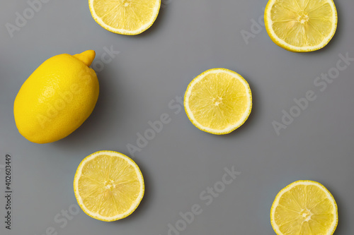yellow-lemons-on-gray-background-colors-of-the-year-2021-pantone-illuminating-and-ultimate-gray-flat-lay