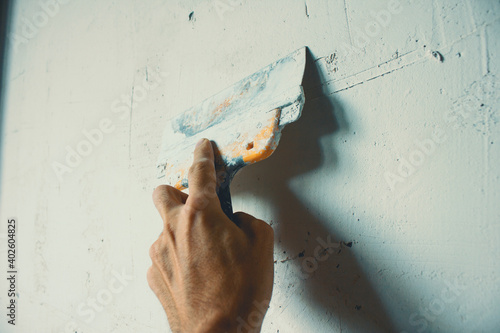 Fotografie, Obraz to repair a wall of putty in hand