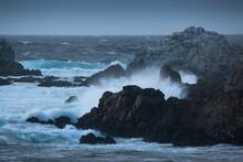 Waves Crashing Onto A Rocky Shore