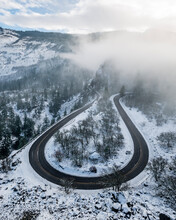 Horseshoe Bend At Rowena Crest As Highway 30 Road Curves And Twists Around High Bluffs Along On The South Side Of The Columbia River Gorge, Mosier, Oregon. This Winter Scence Features Snow And Fog.