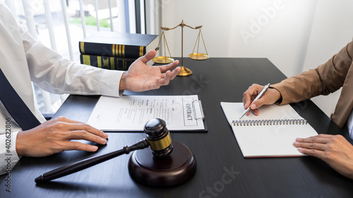 Fototapeta Lawyer or judge present client with contract document papers, Law and Legal serv