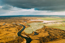 Aerial View Of Dry Grass And Partly Frozen River Landscape In Late Autumn Day. High Attitude View. Marsh Bog. Drone View. Bird's Eye View
