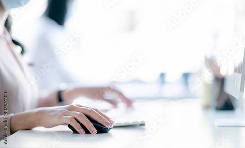Closeup of woman hand clicking mouse outdoor