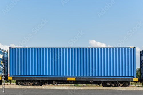 Photo Cargo train platform with freight train Containers on the train on crane loading in port background