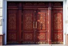 Wide Closed Brown Carved Door