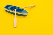 One Blue Toy Boat. Small Boat Models With Oars
