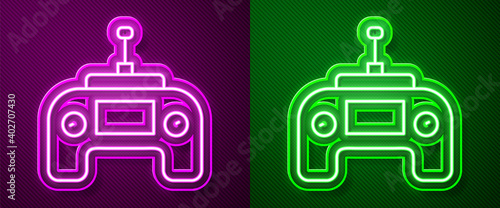 Tela Glowing neon line Drone radio remote control transmitter icon isolated on purple and green background