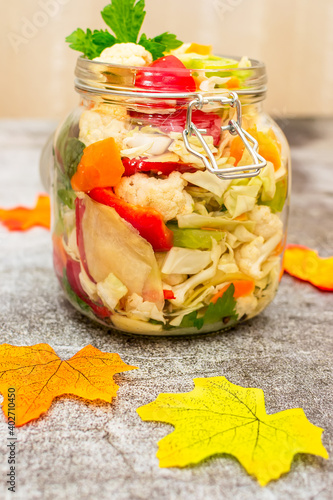 Fototapeta Jar of pickled cauliflower, red bell peppers and carrots obraz