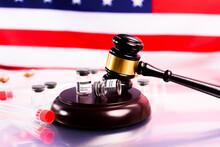 The Covid Vaccine Is Legal In The United States And Has Not Committed A Crime, Vial Threatened With Gavel.