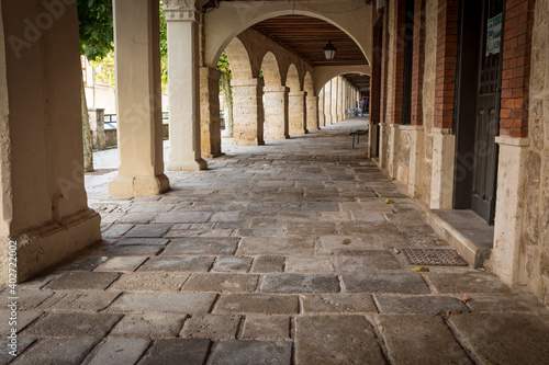 Fotografie, Obraz colonnade with arcades at the main square (Plaza Mayor) in Castrojeriz, province