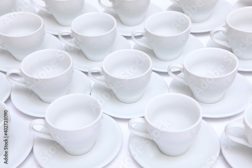 Fotografie, Obraz A large number of white porcelain or ceramic tea pairs on the table