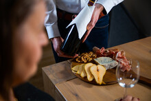 Wine Tasting With Tapas, Meat Board, Cheese Board. The Sommelier Presenting Guest A Bottle Of Red Wine.