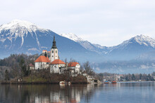 Castle On Lake Bled In Slovenia Against The Background Of Mountains In The Winter Season
