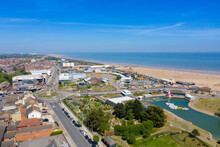 Aerial Photo Of The Town Centre Of Skegness Showing The Pier On The Sandy Beach Near Fairground Rides In The East Lindsey District Of Lincolnshire, England