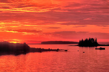 Beautiful And Colorful Coastal Maine Scene. Brilliant Sunrise Over Gulf Of Maine, Painting Clouds And Sky Vibrant Hues Of Red, Orange, And Yellow.