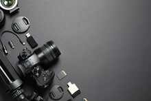 Flat Lay Composition With Camera And Video Production Equipment On Black Background. Space For Text